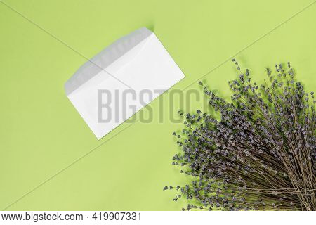 Greeting Card With Bouquet Of Dry Purple Fragrant Lavender And Envelope For Letters On  Blue Paper B