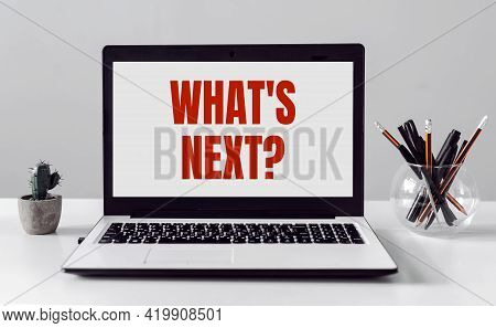Laptop With Text - What's Next On Modern Office Background.
