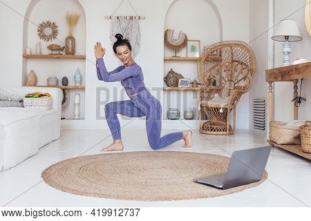 Woman Exercising Watching Online Videos On Laptop, Doing Lunge Exercises Watching Online Exercise Se