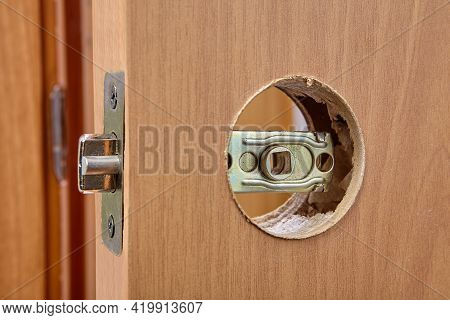 Latch Assembly Is Inserted Into Door Hole During Installation.