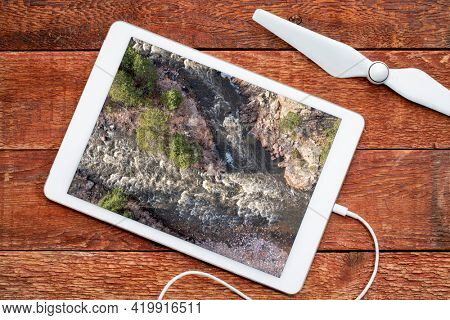 mountain river rapids - Poudre River in the canyon above Fort Collins, Colorado in early spring scenery, reviewing aerial image on a digital tablet