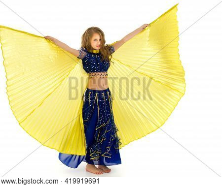 Blonde Girl In Oriental Costume Dancing Belly Dance With Wings