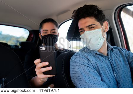 Woman Showing Something On Phone To Cab