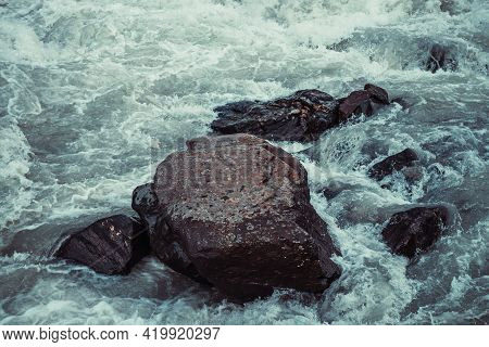 Atmospheric Nature Background With Giant Stones In Mountain River. Big Rocks In Powerful Water Strea