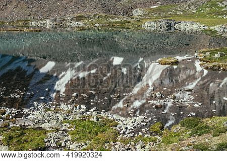 Snowy Mountain Reflected In Clear Water Of Glacial Lake. Beautiful Sunny Landscape With Snow-white G