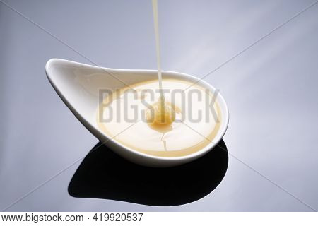 Close Up Of Condensed Milk Isolated On The Table Background, Food And Dessert Concept