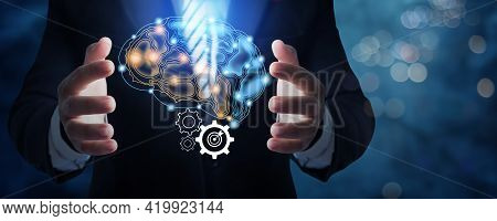 Businessman In Suit Holding Brain Connection Icon Active And Idea To Work And Plan Concept