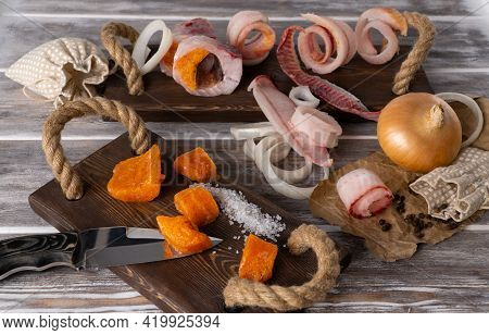 Sliced Frozen Fish. Selective Focus. Raw Frozen Fish Cut Into Shavings On A Wooden Background.
