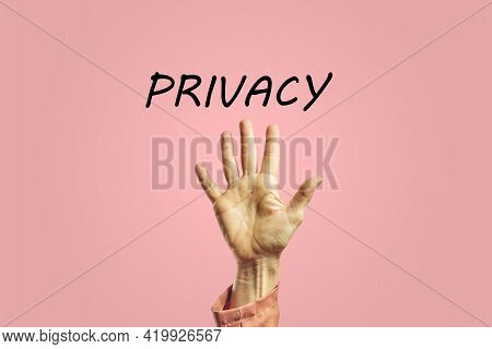 Palm Of A Hand Of A Woman Next To The Word Privacy. Privacy Concept