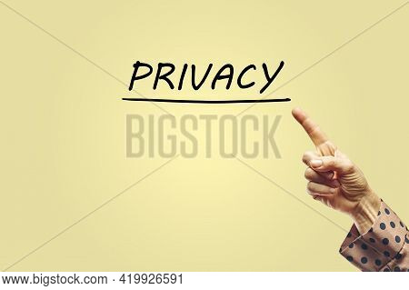Hand Of A Woman Pointing To The Word Privacy. Privacy Concept