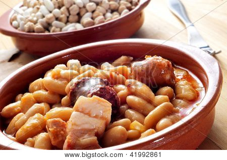 closeup of a plate with fabada asturiana, a typical spanish bean stew
