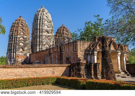 Ruins Of The Ancient Khmer Temple Wat Si Sawai Close-up On A Sunny Day. Sukhothai, Thailand