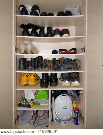 Hong Kong - 10 May, 2021: Bended Shoes Rack In A Shoes Cabinet With Many Shoes