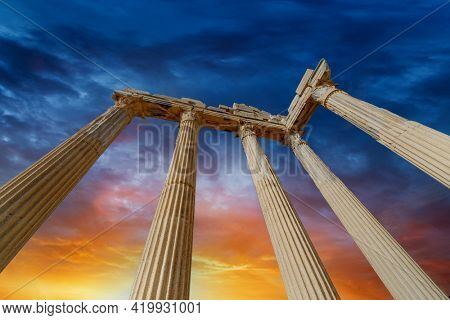 Architectural columns from the times of ancient greece. Ruins against the sunset sky. Side turkey