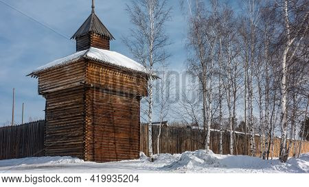 Wooden Architecture. Watchtower On The Perimeter Of The City Wall. Made From Natural Unpainted Logs.