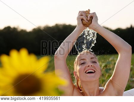 Young, Beautiful, Sexy, Sensual Woman, Blond, Taking A Bath In Nature In The Sunset With Yellow Sunf