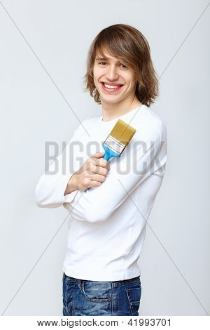 Man with paint brushes