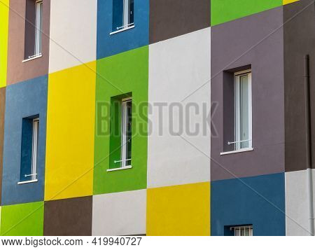 Facade Of A House Divided Into Rectangular Spaces Colored Different Ways.