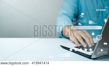 Businessman Are Working On The Laptop Keyboard To Use The Search Engine Optimization Tool. To Find C