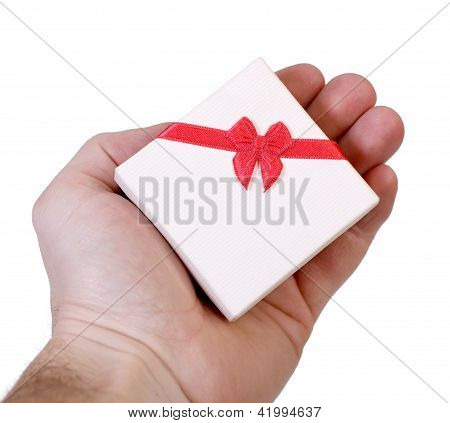 Gift box in a male hand