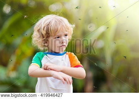 Mosquito On Kids Skin. Little Boy Attacked By Mosquitoes In Tropical Forest. Insect Repellent. Malar