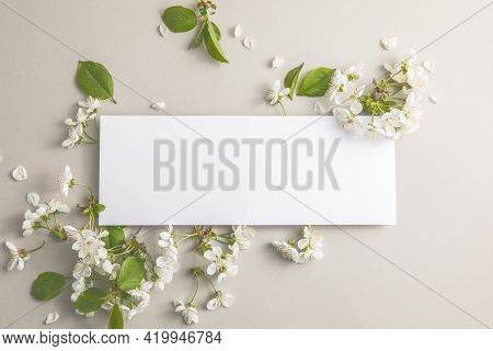 Elegant Floral Composition With Paper Blank In The Centre Of  Gray Background. Branding Mock Up, Hol