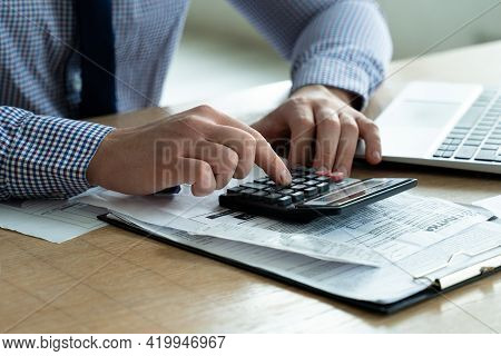 Concept Of Tax Deduction Planning. Businessman Who Calculates The Business Balance On A Calculator I
