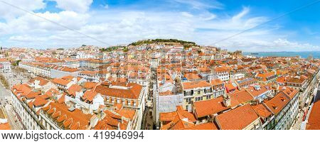 Beautiful Panoramic View From The Center Of The Portuguese City Of Lisbon. Above The City Stands The