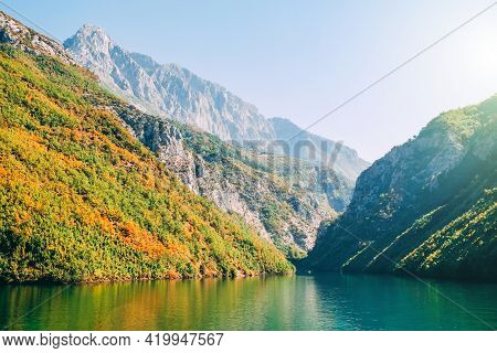 Beautiful Lake Komani Located In Northern Albania With Cliffs, Mountains And Forests. Sunny Weather