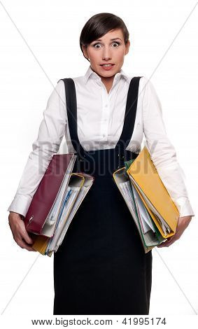 Stressed and overworked businesswoman holding document folders isolated on white