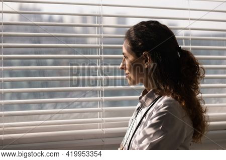 Young Latin Woman Medic Therapist Stand By Window With Smile