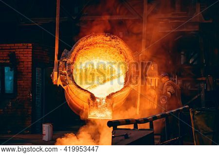 Molten Metal In Big Ladle Container. Iron Casting In Metallurgy Foundry Plant, Heavy Industry.