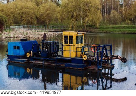 River Cleaning Boat Collects Garbage On Water. Trash Skimmer Boat. Floating Debris Removal Systems.