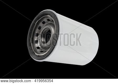 Car Oil Filter Isolated On Black Background With Clipping Path. Oil Car Filter Isolated. Quality Spa