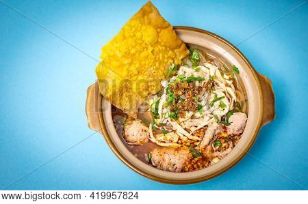 Thai Spicy Chicken Noodle Soup Isolated On Blue Background, Top View Table. Stir-fry Noodles With Ch