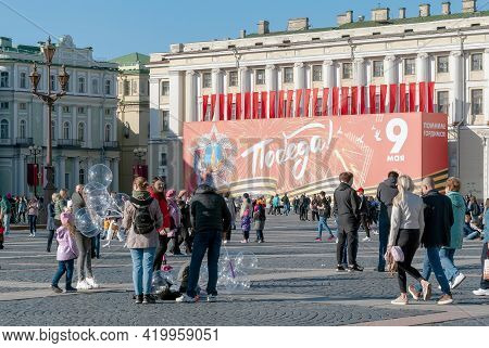 Saint-petersburg, Russia - May 9, 2021: People On  The Palace Square Near The State Hermitage Buildi
