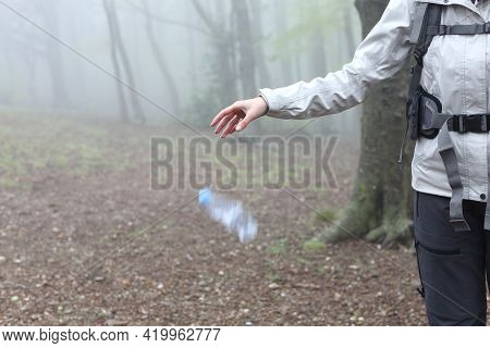 Close Up Of An Uncivil Trekker Throwing Garbage To The Ground In Nature