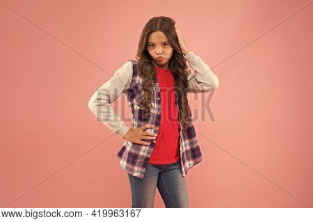 Palyful And Cute Look. Coquettish Girl Pout Lips With Beauty Look. Vogue Look Of Small Child. Casual