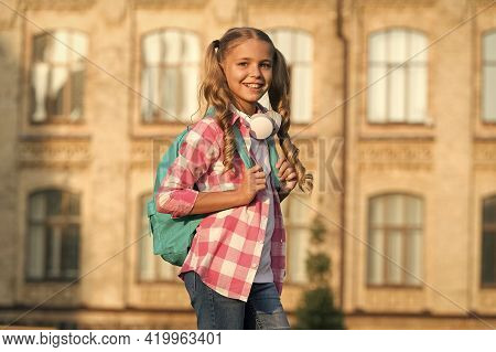 School Life. Student. Modern Education. Cheerful Teen Listening Music. Schoolgirl Going To School. S
