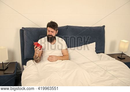 Its Hard To Get Out Of Bed. Bearded Man Check Time With Alarm Clock. Sleep Time. Sleep And Wake Rout