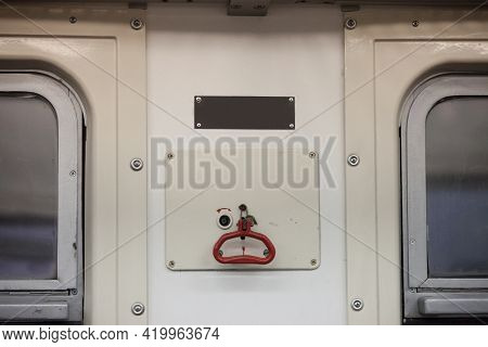 Handle Of A Train Emergency Brake System In A Passenger Car Wagon With Its Iconic Red Lever Used To