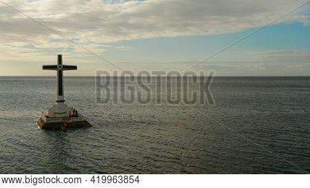 Catholic Cross In Sunken Cemetery In The Sea At Sunset, Aerial View. Sunset At Sunken Cemetery Camig