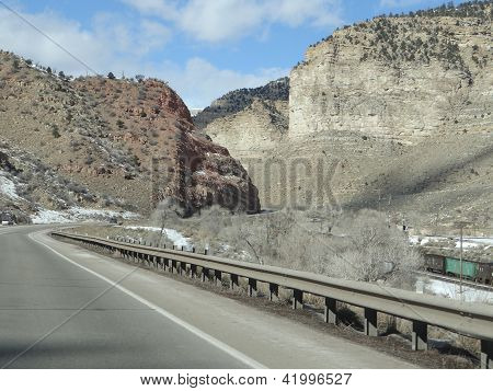 Freight Train Runs Through A Narrow Canyon