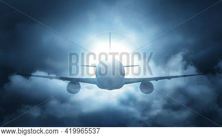 The Concept Of Dangerous Flights. The Plane Flies Against A Gloomy Background. 3d Illustration.