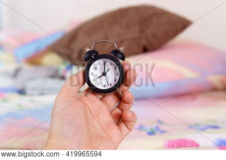 Alarm Clock In Hand. Morning Of A New Day, Alarm Clock Wake Up. Health And Care Concepts.