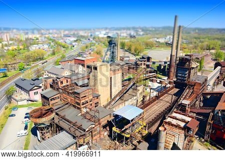 Aerial View Of The Old Rusty Abandoned Ironworks Factory Area With A Tilt-shift Effect. Miniature Ti