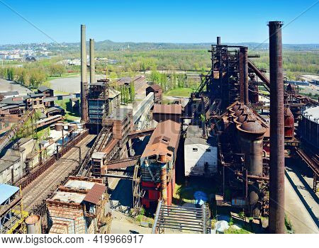 Aerial View Of The Old Rusty Abandoned Ironworks Factory Area. Old Ironworks Factory With Chimneys.