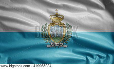 Sammarinese Flag Waving In The Wind. San Marino Banner Blowing Soft Silk.