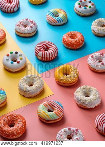 Assorted Colorful Glazed Donuts, Perspective View. Creative Layout Made From Delicious Glazed Donuts