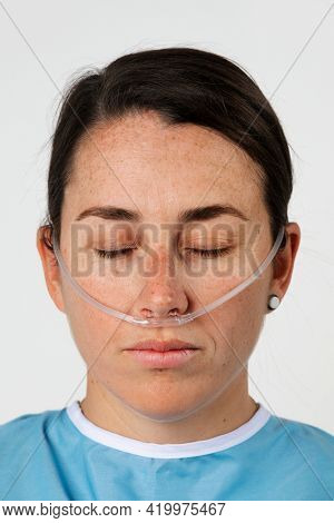 Sick female patient with a nasal cannula
